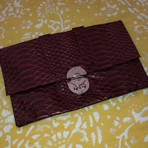 Burgundy patent leather envelope clutch